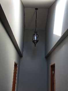 Parker's Electrical NQ installing a light
